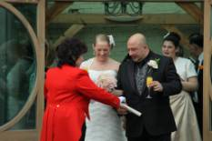 Toastmaster presenting marriage certificate to Bride and Groom after their wedding ceremony at Gaynes Park, Essex Near London